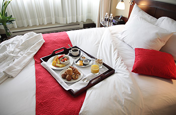 Breakfast in bed at Le Saint-Sulpice Hôtel Montréal
