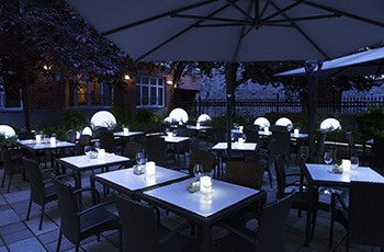 Garden terrace by night at Le Saint-Sulpice Hôtel Montréal