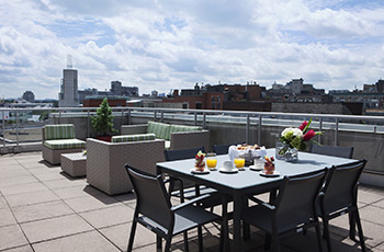 Signature suite rooftop terrace with a view at Le Saint-Sulpice Hôtel Montréal