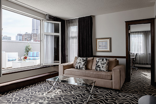 Signature Suite with open window in Old Montreal