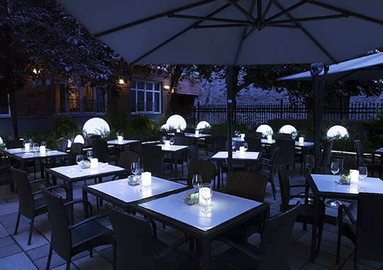 Terrace of Sinclair restaurant at night in Old Montreal